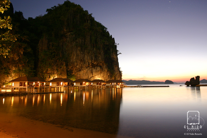El Nido Lagen Island Resort water cottages at dusk